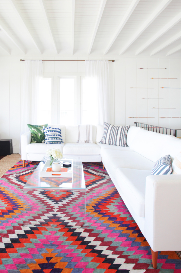 southwestern living room furniture. white and colorful southwestern style living room via StyleMePretty  photo Tessa Neustadt Remodelaholic Inspiration File Wild Modern Southwestern Style