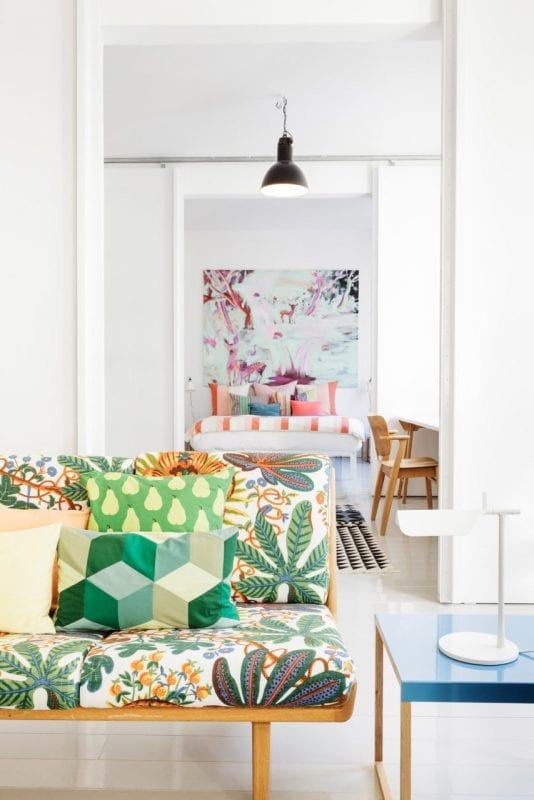 What fun colors and patterns!   Modern Tropical Style on Remodelaholic.com