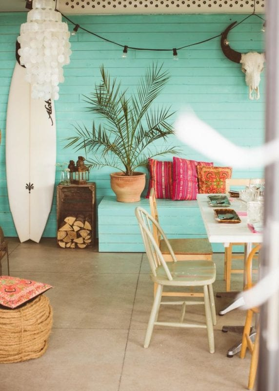 Turquoise plank wall beach house   Modern Tropical Style on Remodelaholic.com