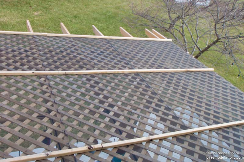 Top view of DIY pergola with lattice and screen, tutorial from The  Heathered Nest on - Remodelaholic DIY Pergola Tutorial: How To Build Your Own Backyard