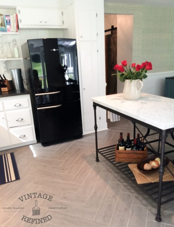 Black appliances in white kitchen renovation, by Vintage Refined featured on @Remodelaholic