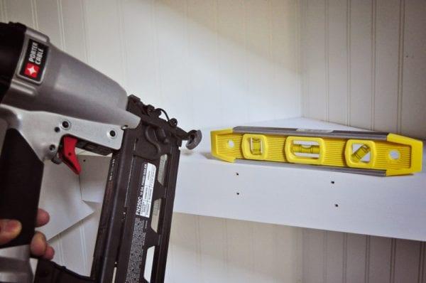 attach a shelf face to a corner floating shelf in a closet organization project