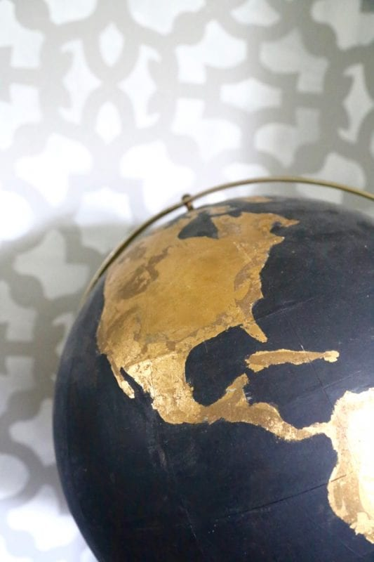 Craft paint and Gold leafing transform a thrifted globe, by Love and Renovations featured on @Remodelaholic