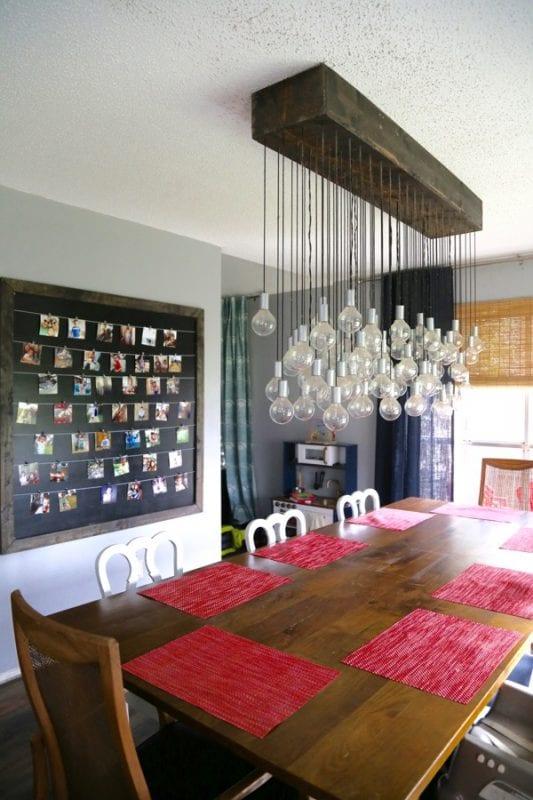 Love & Renovations dining room with multi-bulb DIY light