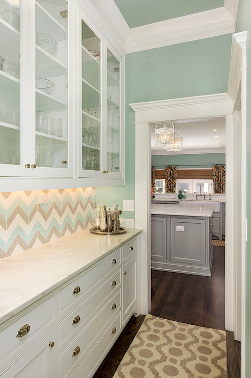 Beautiful butler's pantry, with multi-color herringbone tile backsplash and white cabinets. (Wall color is Wythe Blue from Benjamin Moore.)