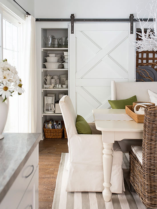 Farmhouse Dining Room In Neutrals With A Sliding Barn Door Via BHG