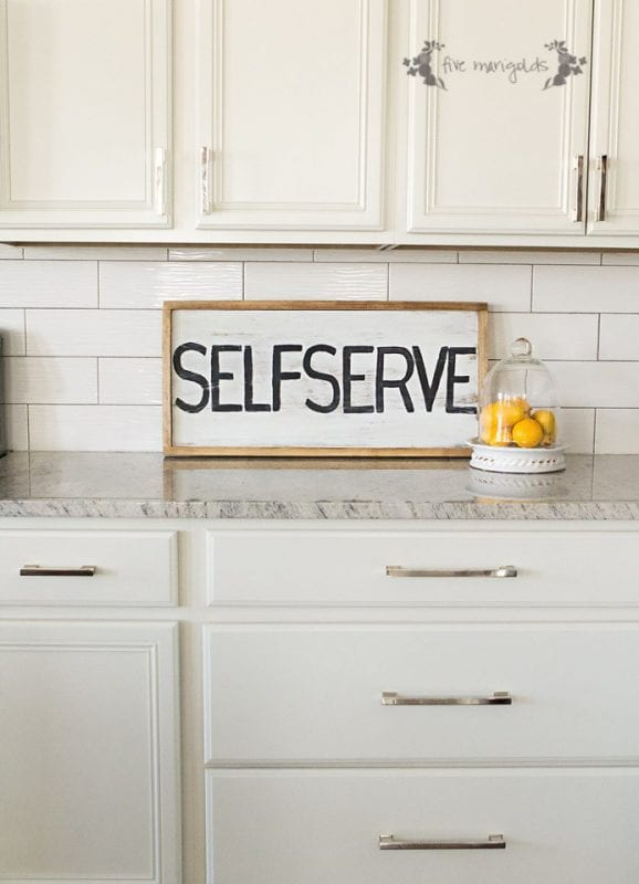 white kitchen with self-serve reversible sign, Five Marigolds
