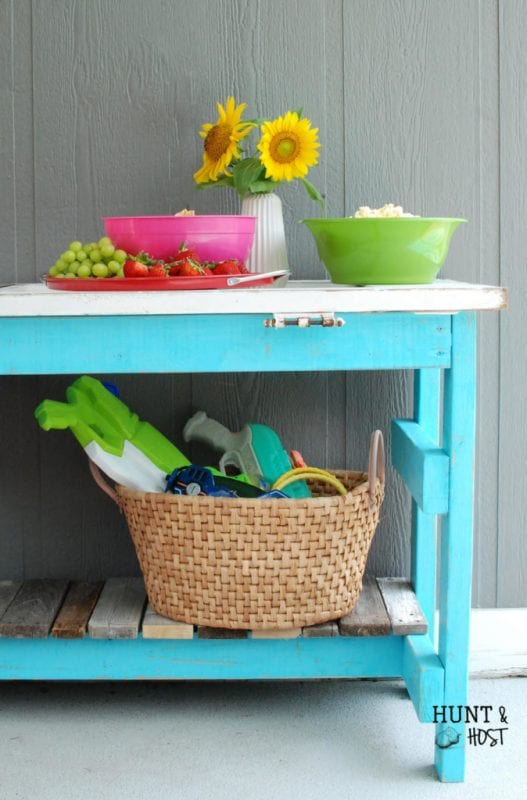 DIY salvaged old door into an outdoor serving table by Hunt and Host featured on @Remodelaholic