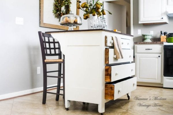 Beautiful handcrafted kitchen island by Vanessa's Modern Vintage Home featured on @Remodelaholic