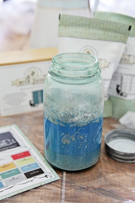 How to use watered down Miss Mustard Seed Milk paint for creating beachy look in a console table by Shabbyfufu featured on @Remodelaholic