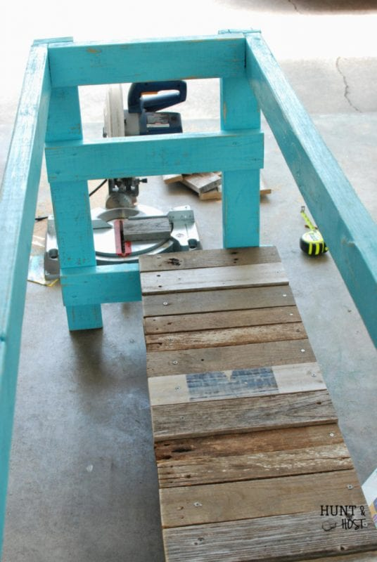 How to build an outdoor table using salvaged materials by Hunt and Host featured on @Remodelaholic