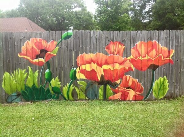 beautiful fence mural by Lori Anselmo Gomez in Pearl River, Louisiana