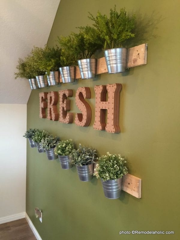 easy wall of herbs made from cheap IKEA buckets via @remodelaholic 5