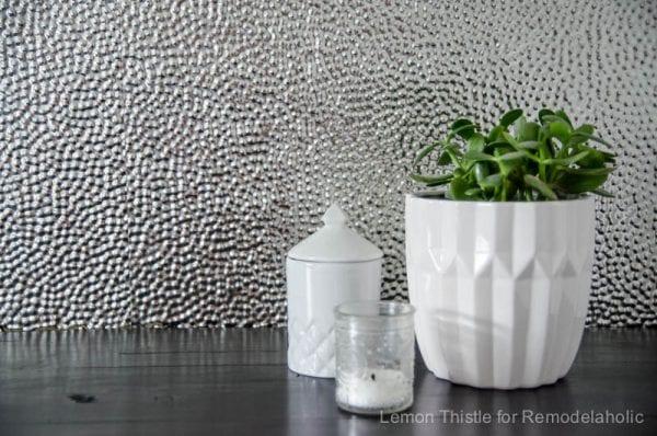 DIY laundry backsplash out of steel ceiling tiles