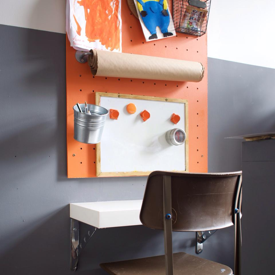 Great use IKEA buckets and wall rails on a pegboard for a kids art station by Grillo