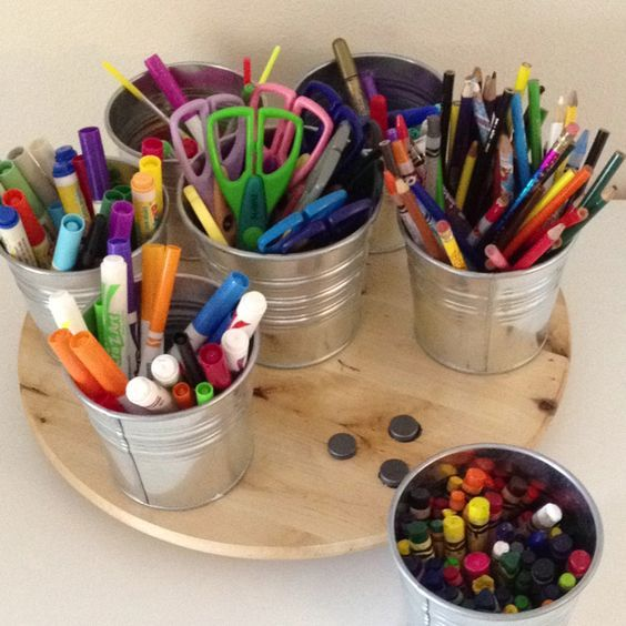 use a lazy susan and magnets with cheap metal buckets from IKEA to make a great craft supply organizer for the kids @Remodelaholic