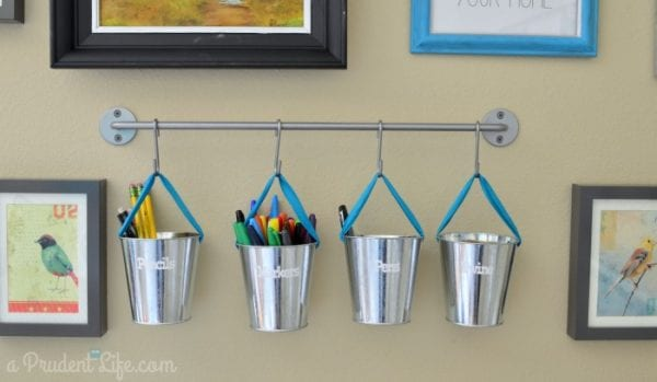use inexpensive buckets and a wall storage rail for craft room storage, Polished Habitat