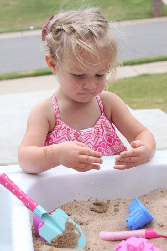 DIY kids sand and water table by Tattered and Inked featured on @Remodelaholic