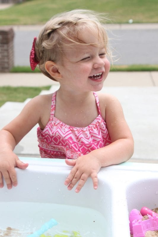 Diy kids water and sand table from old kitchen sink by Tattered and Inked featured on @Remodelaholic