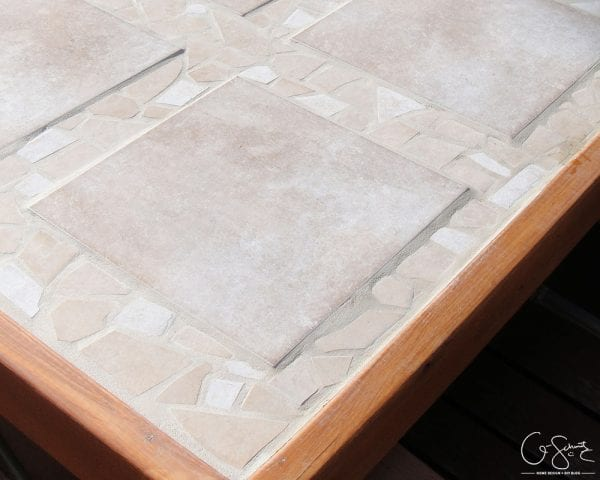 How to use broken tile to create a beautiful table top for outdoor use by Q-Schmitz featured on @Remodelaholic