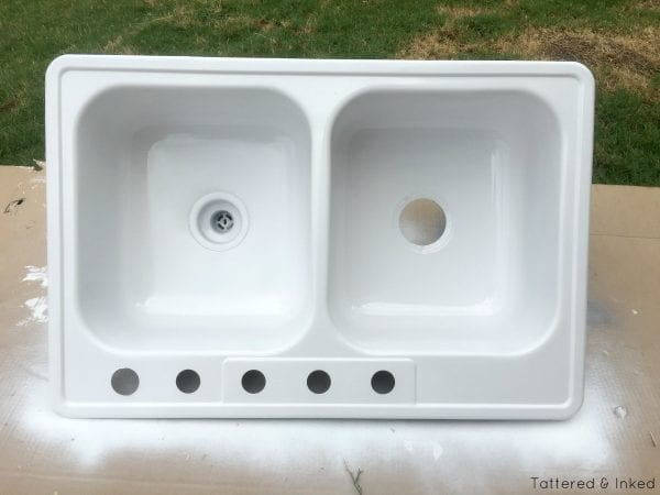 Kitchen sink to kids water table, DIY by Tattered and Inked featured on @Remodelaholic