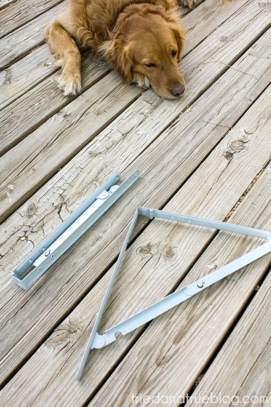 Folding brackets for DIY table or shelf by Tried and True featured on @Remodelaholic