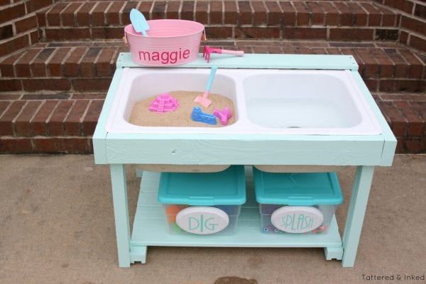 Adorable kids sand and water table from an old kitchen sink by Tattered and Inked featured on @Remodelaholic