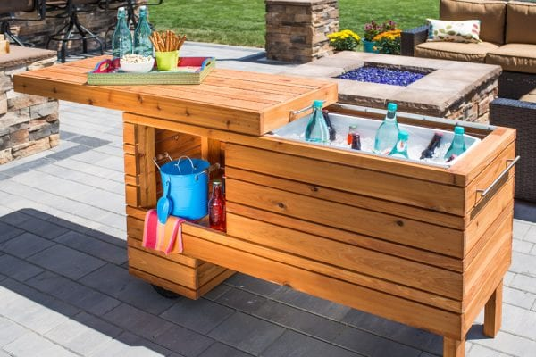 build an outdoor serving center with a built-in cooler and a slide-away cover, via BuildSomething