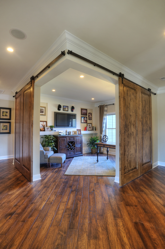 Remodelaholic friday favorites barn door corner office for Corner sliding glass doors