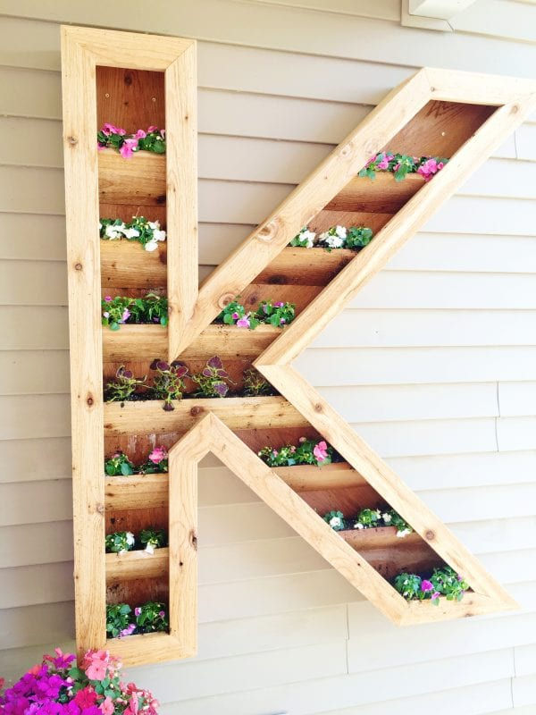 This HUGE DIY monogram planter is next on my to-do list! I love that it has rows of planting space so I can re-plant as often as I want.