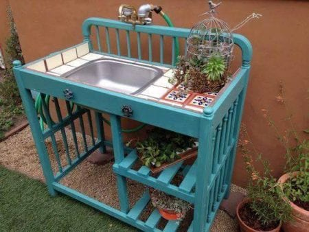 upcycled crib or changing table into a potting bench using an old sink