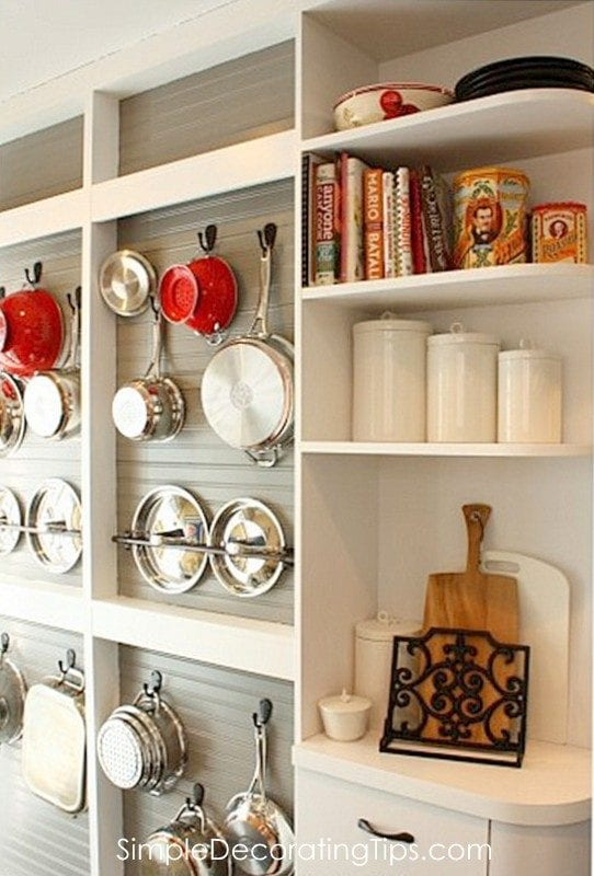 DIY kitchen remodel with cookware storage built onto the wall by Simple Decorating Tips featured on @Remodelaholic