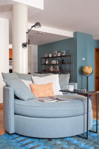 Accent wall color is Aegean Teal from Benjamin Moore. Color Spotlight on Remodelaholic. Image via Revamp Interior Design.