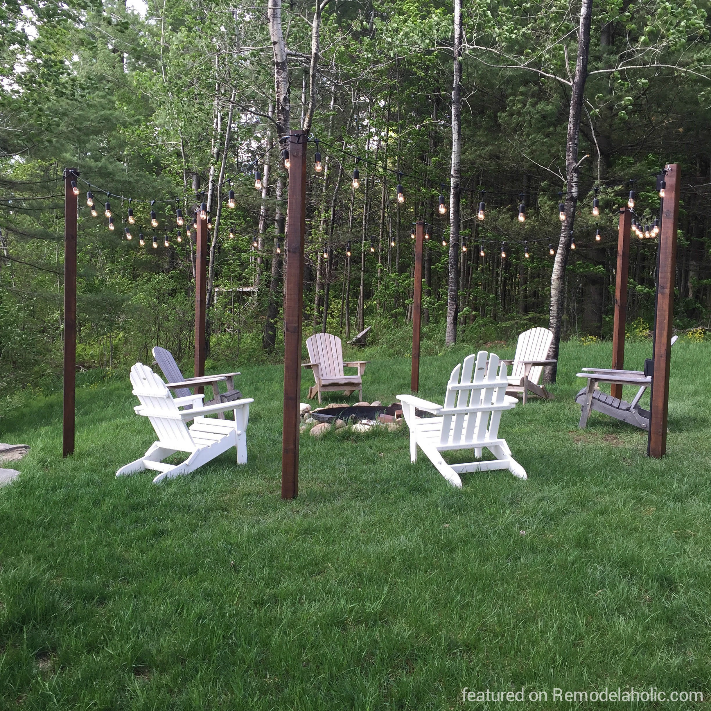 diy garden string lights. diy easy outdoor string lighting posts around a fire pit and seating area, featured on diy garden lights