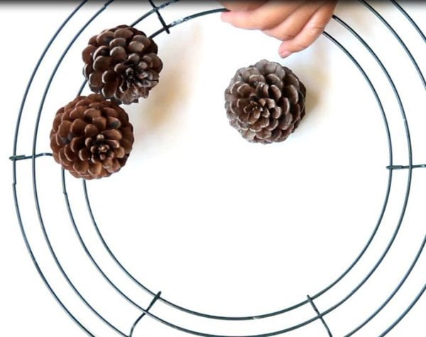 Make a pinecone wreath in one hour with this tutorial by A Piece of Rainbow on Remodelaholic