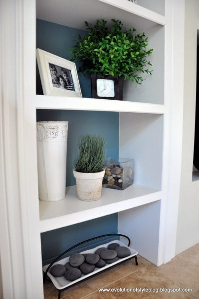 Inside of Bookshelves Painted with Aegean Tel Benjamin Moore. Color Spotlight on Remodelaholic. Image via Evolution of Style
