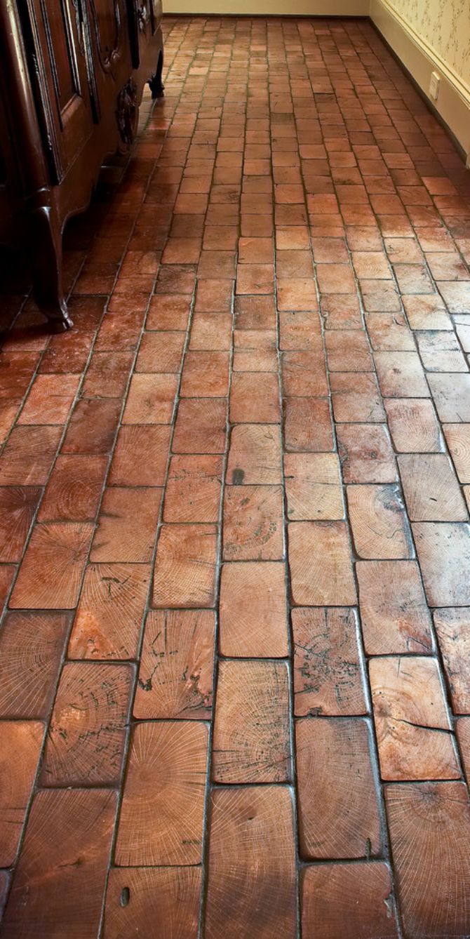 Remodelaholic friday favorites wood block floor and a for Wood floor knocking block