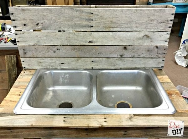 Pallets And An Old Kitchen Sink Repurposed Into