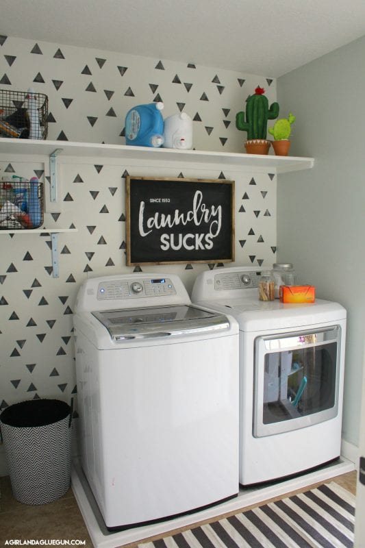 laundry-room-makeover-with-triangle-pattern-painted-wall-a-girl-and-a-glue-gun