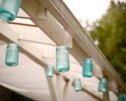 Blue Mason Jars hanging on white gazebo