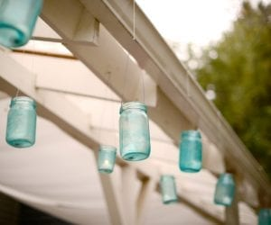 Blue Mason Jars hanging on white gazebo