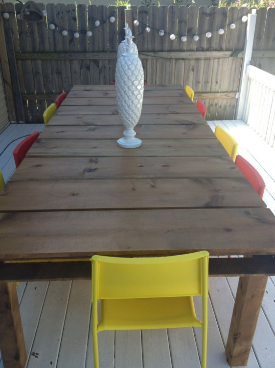 Outdoor dining table out of pallets and 15 awesome pallet furniture ideas featured on remodelaholic.com