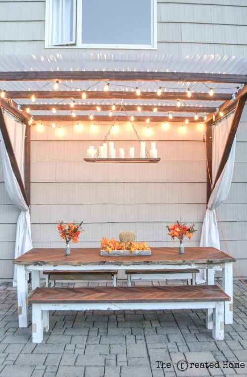 Remodelaholic how to make your own rustic candle outdoor for Rustic outdoor chandelier