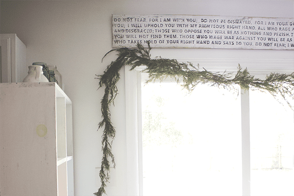 8 DIY Fresh Pine Garland In Rustic White Kitchen, By We Lived Happily Ever After Featured On @Remodelaholic