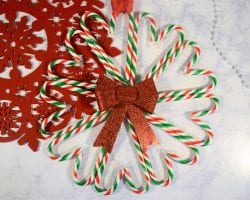 Candy Can Wreath tutorial using a sparkly bow