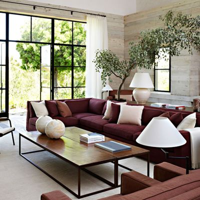 Decorating a neutral living room, with a maroon couch