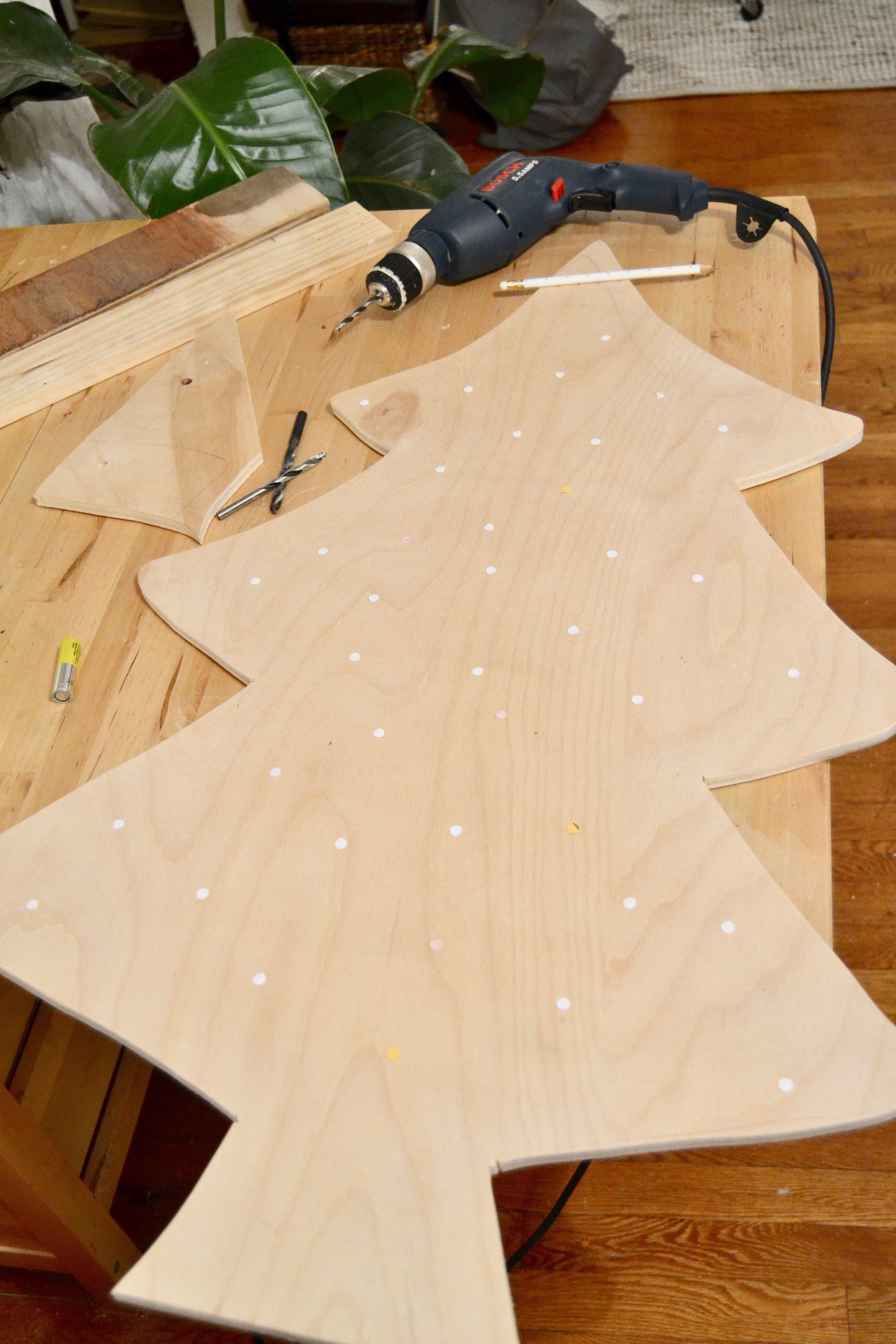 Remodelaholic easy diy plywood christmas tree with lights for Plywood christmas tree