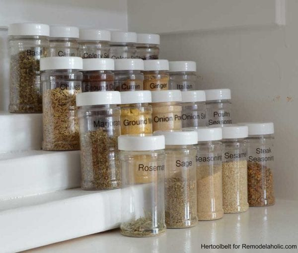 This is such an easy project to organize spice bottles. Build a simple tiered spice rack from a 2x4 wood board with free plans on Remodelaholic.