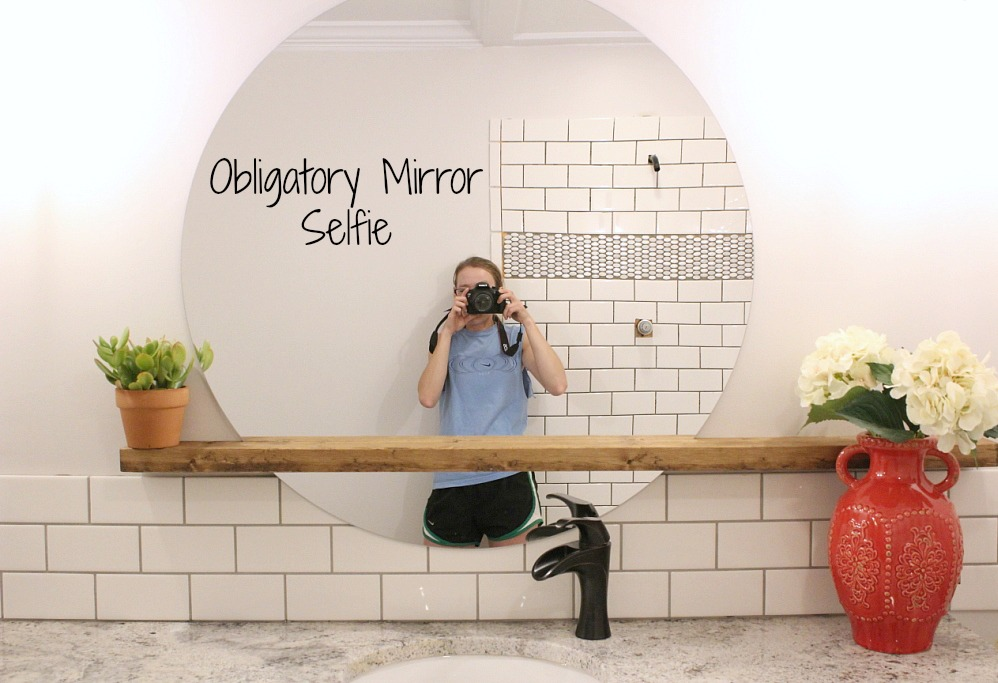 modern bathroom round sunrise floating mirror DIY Woodshop Diaries featured on remodelaholic 3