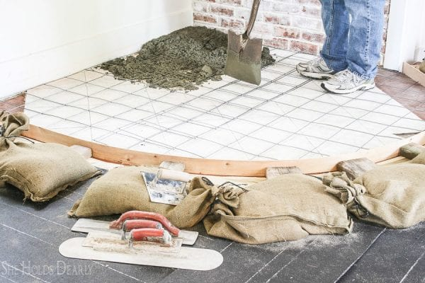 7 Tutorial For Updating A Tile Hearth To A Concrete Hearth By She Holds Dearly Featured On @Remodelaholic